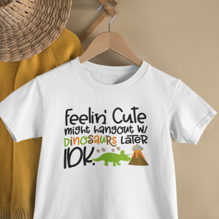 mockup of a kid s t shirt hanging from a wall rack 33736 3