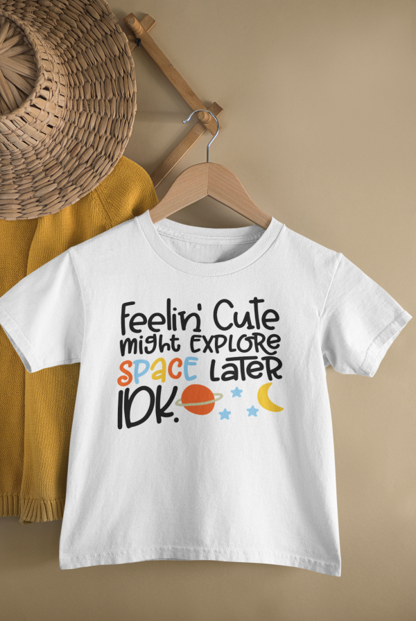 mockup of a kid s t shirt hanging from a wall rack 33736 5