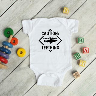 Caution teething scaled